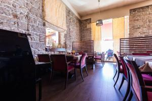 A restaurant or other place to eat at B&B Giardin