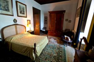 A bed or beds in a room at Solar dos Olivas