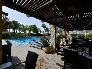 The swimming pool at or near The Apartments, Dubai World Trade Centre Hotel Apartments