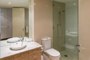 A bathroom at Grand Mercure Allegra Hervey Bay