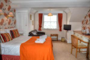 Кровать или кровати в номере The Lion Hotel