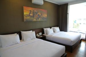 A bed or beds in a room at Samara Resort