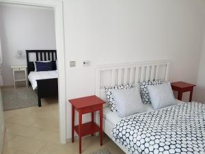 Posteľ alebo postele v izbe v ubytovaní Penzión Lili