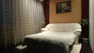 Кровать или кровати в номере Апартаменты на Пушкинской