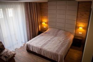 Кровать или кровати в номере Апартаменты на Лесной