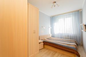 Кровать или кровати в номере Business Brusnika Generala Antonova 4