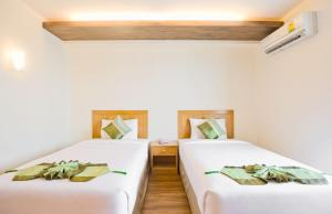 A bed or beds in a room at TM Land Hotel