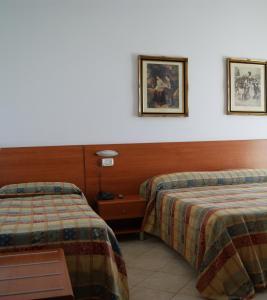 Letto o letti in una camera di Hotel Vico Alto
