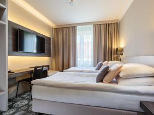 Postelja oz. postelje v sobi nastanitve Hotel Center Novo Mesto