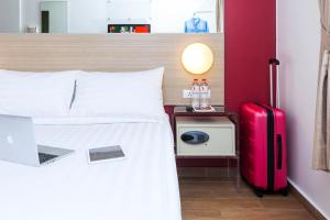 A bed or beds in a room at Red Planet Bekasi