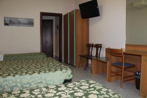 Кровать или кровати в номере Albergo Napoleone