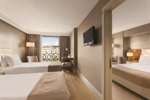 A bed or beds in a room at Ramada Istanbul Grand Bazaar