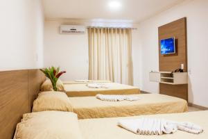 A bed or beds in a room at Portal Ville - Rede Soberano