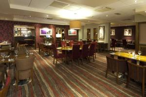A restaurant or other place to eat at Premier Inn London Heathrow Airport T2 & T3 - Bath Road