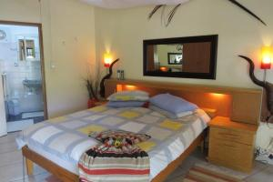 A bed or beds in a room at Maison Ambre Guesthouse