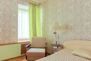 Кровать или кровати в номере Апартаменты на ул. Казанская, д. 9