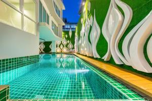 The swimming pool at or near Anajak Bangkok Hotel