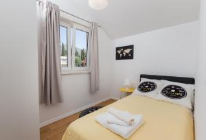 A bed or beds in a room at Apartment Green Oase
