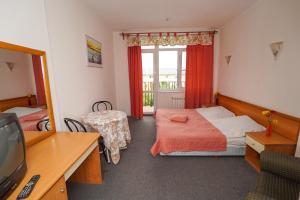 Кровать или кровати в номере Гостиница у Моря