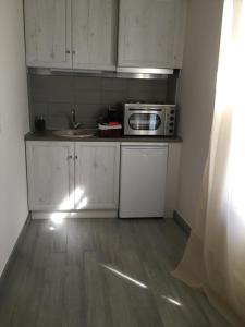 Η κουζίνα ή μικρή κουζίνα στο Kochyli Hotel