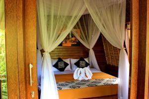 Llit o llits en una habitació de A_One House