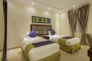 Cama ou camas em um quarto em Taleen Hafsa Al Rawdah