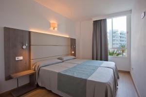 Cama o camas de una habitación en Aparthotel Playa Dorada