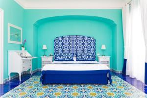 Letto o letti in una camera di Villa Eliana