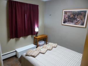 A bed or beds in a room at Bent Prop Inn & Hostel of Alaska - Downtown