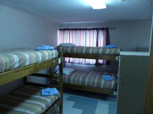 A bunk bed or bunk beds in a room at Bent Prop Inn & Hostel of Alaska - Downtown