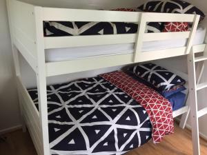 A bunk bed or bunk beds in a room at Melba Beach Bunker