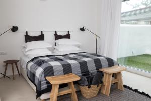 A bed or beds in a room at Sea Sense Boutique Hotel