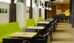 A restaurant or other place to eat at Green Vilnius Hotel