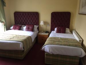 Un ou plusieurs lits dans un hébergement de l'établissement Faythe Guesthouse