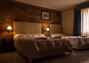 Una cama o camas en una habitación de Calafate Hostel