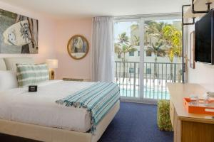 A bed or beds in a room at Plunge Beach Resort