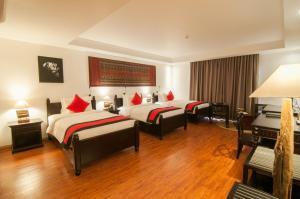 Ein Bett oder Betten in einem Zimmer der Unterkunft La Rose Suites