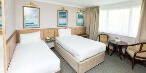 A bed or beds in a room at Marks Tey Hotel Sure Hotel Collection by Best Western
