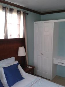 A bed or beds in a room at Believe Caribbean Apartment