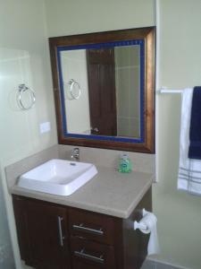 A bathroom at Believe Caribbean Apartment