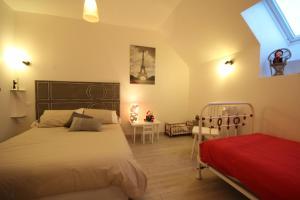 Un ou plusieurs lits dans un hébergement de l'établissement Gites La Haute Borde