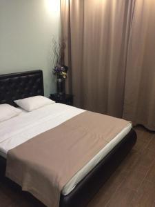 Кровать или кровати в номере Hotel MADO