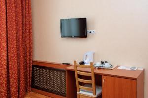 Телевизор и/или развлекательный центр в Гостиница Киль