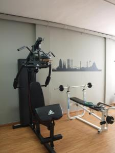The fitness center and/or fitness facilities at Aparthotel Bertrán