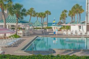 The swimming pool at or near Sandcastle Resort at Lido Beach
