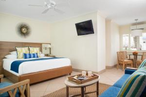 A bed or beds in a room at High Noon Beach Resort