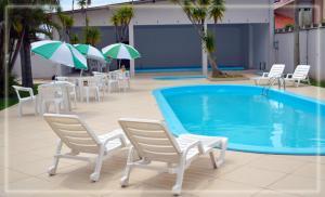 A piscina localizada em Hotel das Figueiras ou nos arredores