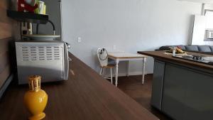 A kitchen or kitchenette at Motel L'Anse De La Lanterne