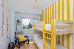 A bunk bed or bunk beds in a room at Lisbon Airport Hostel