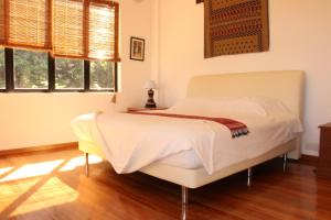 A bed or beds in a room at Nanga Damai Homestay